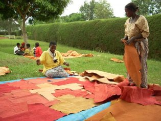 Women in Uganda sewing barkcloth pieces together. Credit: Barktex