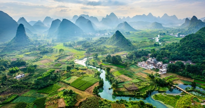 Landscape of mountains, forests and fields in Guilin, China - iStock/IPBES