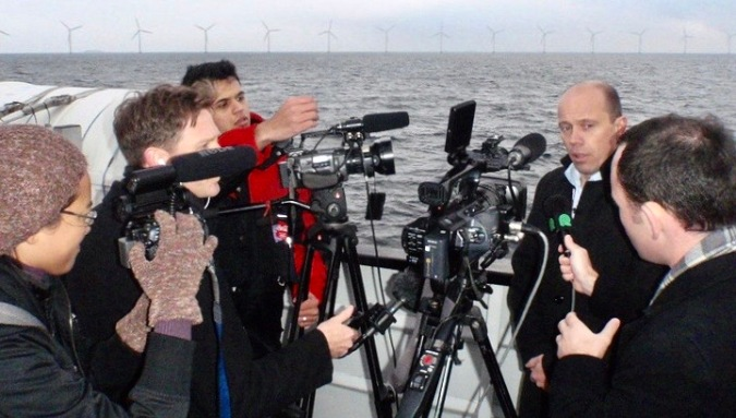 EJN Climate Change Media Partnership Fellows, including Pierre Fitter from India, Gustavo Bonato from Brazil and Pia Faustino from the Philippines, interview a Danish wind energy executive.